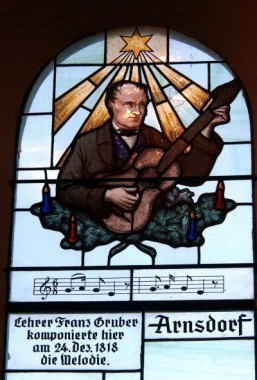 A stained glass window with a portrait of composer Franz Xaver Gruber at the Silent-Night-Memorial-Chapel ©AFP PHOTO/ JOE KLAMAR