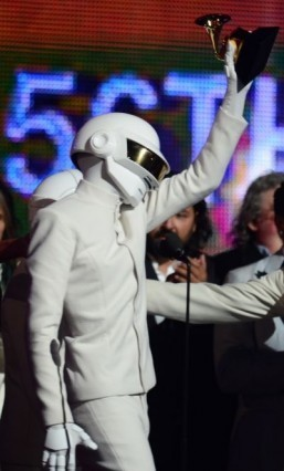 "Winners for Best Record Of The Year ""Get Lucky"" Daft Punk celebrate on stage during the 56th Grammy Awards at the Staples Center in Los Angeles, California, January 26, 2014. ©AFP PHOTO FREDERIC J. BROWN"