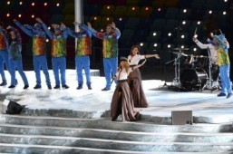 Yulia Volkova (C-top) and Lena Katina (C-bottom) of t.A.T.u. perform during the Opening Ceremony of the Sochi Winter Olympics at the Fisht Olympic Stadium on February 7, 2014 in Sochi. ©AFP PHOTO / JONATHAN NACKSTRAND