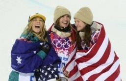 (L-R) Silver Medallist, Australia's Torah Bright; Gold Medallist, US Kaitlyn Farrington; and Bronze Medallist, US Kelly Clark celebrate the Women's Snowboard Halfpipe Flower Ceremony at the Rosa Khutor Extreme Park during the Sochi Winter Olympics on February 12, 2014. ©AFP PHOTO / JAVIER SORIANO