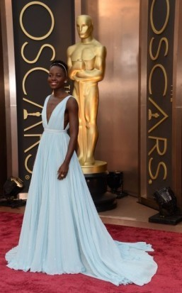 "Nominee for Best Supporting Actress in ""12 Years a Slave"" Lupita Nyong'o arrives on the red carpet for the 86th Academy Awards on March 2nd, 2014 in Hollywood, California. ©AFP PHOTO / Robyn BECK"