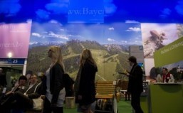 Fair-goers visit the Bavaria stand at the ITB International Travel Trade Fair in Berlin March 5, 2014. ©AFP PHOTO / JOHN MACDOUGALL