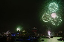 New Year's Eve fireworks erupt over Sydney's iconic Harbour Bridge during the traditional earlier family fireworks show held before the main midnight event on December 31, 2013. ©AFP PHOTO / Greg WOOD