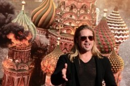 "With ""World War Z,"" Brad Pitt has achieved a new personal record for success at the global box office. US actor Brad Pitt gestures prior to the opening ceremony of the 35th Moscow Film Festival at Rossiya theatre in Moscow on June 20, 2013. ©AFP PHOTO/KIRILL KUDRYAVTSEV"