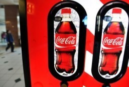 US beverage giants vow to cut calories to fight obesity
