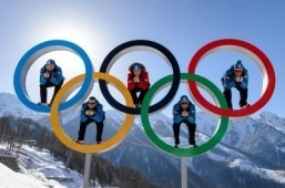 Austrian alpine skiers (LtoR) Georg Streitberger, Klaus Kroell, Max Franz, Joachim Puchner, Romed Baumann pose in the Olympic Rings on February 4, 2014 at the Mountain Olympic Village at the Rosa Khutor Alpine centre, four days prior to the start of the 2014 Sochi Winter Olympic Games. ©AFP PHOTO / FABRICE COFFRINI
