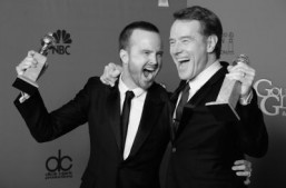 "Actors Aaron Paul (L) and Bryan Cranston (R) celebrate winning Best Series - Drama for ""Breaking Bad"" in the press room during the 71st Annual Golden Globe Awards in Beverly Hills, California, January 12, 2014. ©AFP PHOTO / Robyn BECK"