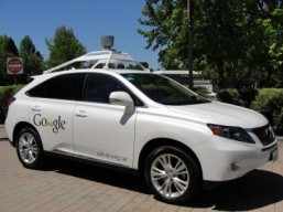 Car industry welcomes Google, Apple but battles loom