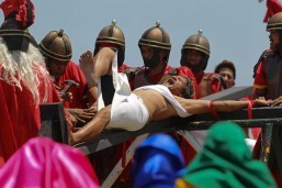 Ruben Enaje reacts after being nailed on the cross during the reenactment of the crucifixion of Jesus Christ in Cutud, Pampanga on Good Friday. Eñaje is one of several penitents who have themselves nailed on the cross. (MNS photo)