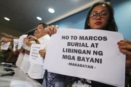 Marcos' remains transferred into coffin; mausoleum closed to public
