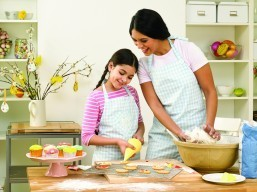 Asian mother and child Easter baking (Photo courtesy of Getty Images)