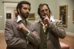 """American Hustle"" stars Bradley Cooper and Christian Bale ©2013 Annapurna Pictures. Atlas Entertaiment. All Rights Reserved."