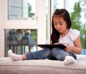 Tablets replacing TV, teachers and babysitters: Nielsen