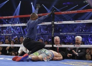 Filipinos silenced, stunned by Pacquiao loss