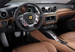 The 2014 Ferrari California T Inside the car gets a new touch screen and the same multifunction steering wheel found in the 458 Italia and F12 Berlinetta. ©Ferrari