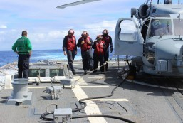 INDIAN OCEAN (March 16, 2014): Sailors inspect the flight deck of the Arleigh Burke-class destroyer USS Kidd (DDG 100). Kidd is conducting search and rescue operations in the Indian Ocean for the missing Malaysian Airlines flight MH370. U.S. Navy photo (Released) 140316-N-ZZ999-002