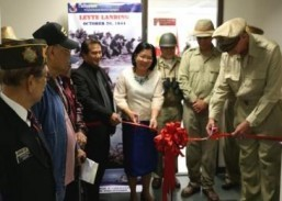 Consul General Ma. Hellen Barber De La Veda with Mr. Robert Tidwell as Gen. Douglas MacArthur at the ribbon-cutting ceremony launching the exhibit commemorating the 69th Anniversary of the Leyte Landing.