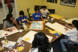 Balita file photo of UCLA students make posters in preparation for an immigration rally in downtown Los Angeles. The US Supreme Court has just decided the law on aged-out children does not protect the children of all family immigrant visa applicants to immigrate with their US citizen parents.