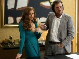 "Amy Adams and Christian Bale star in ""American Hustle"" ©Annapurna Pictures. Atlas entertainment. All Rights Reserved."