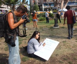 An unidentified DREAMers supporter construct a handmade sign while protestors mass up at the MacArthur Park on Sunday (September 10).