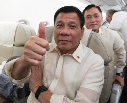 President Rodrigo Roa Duterte does the thumbs up gesture while awaiting his departure of Philippine Airlines Flight PR-001 bound for Singapore where he is scheduled for a state visit on Thursday (December 15, 2016). Also in photo is Special Assistant to the President Christopher Lawrence Go. (Photo by King Rodriguez/PPD/PNA)