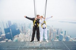 Thrill-seeking couple wed hanging off the edge of CN Tower