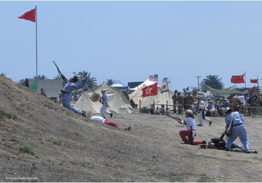 Photo above shows members of the Philippine Scouts Heritage re-enacting Filipino assaults in the Philippine-American War.