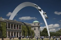Mercedes-Benz cars arc through the sky at the Goodwood Festival of Speed