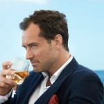 Jude Law dances in his latest role as spokesman for whisky