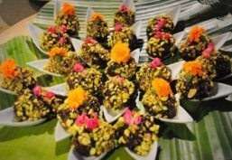 "The Impossible Island from ""Life of Pi"" interpreted as black rice balls with yuzu and edible flowers ©Chantal Hintze"