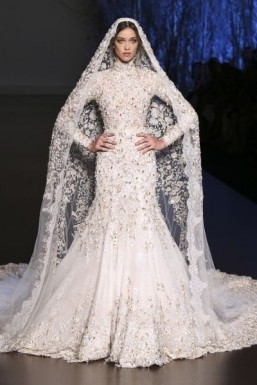 Ralph & Russo - Haute Couture - fall/winter 2015-2016 Though more traditional, Ralph & Russo's gown is no less impressive, if only because of the amazing work done on the embroidery. Embroidered with pearls, the gown is worn with a very long train. A real fairytale wedding gown. ©Ralph & Russo