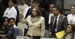 State witness Ruby Tuason takes her oath Thursday (Feb. 13, 2014) before the Senate Blue Ribbon Committee hearing on the pork barrel anomaly as Justice Secretary Leila de Lima (right) and whistle-blower Benhur Luy (left) look on. (MNS photo)
