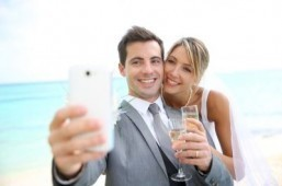 "No need to take any more ""shameless selfies."" A social media wedding concierge will take Instagram photos and live-tweet your wedding for a paltry $3,000. ©goodluz/shutterstock.com"