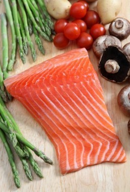 Eating a weekly portion of salmon or other fatty fish could significantly reduce your risk of developing rheumatoid arthritis, a new study finds. ©Paul Cowan/shutterstock.com