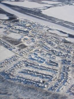 Aerial view of Inuvik, Northwest Territories The extension of the Dempster Highway, for which ground was broken this week, is to connect Inuvik to Tuktoyaktuk, a hamlet on the Arctic coast currently accessible only by winter ice road, barge or air. ©Max Lindenthaler/shutterstock.com