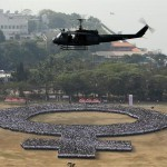 Over 10k Pinoys form women symbol at Luneta for Women´s Month